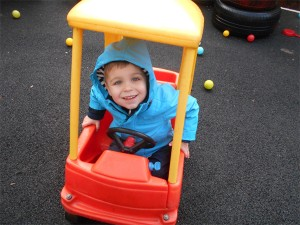child-in-toy-car